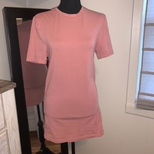 Long tee- fits over your bottom. Cute w leggings!